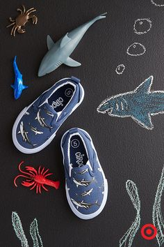 Your little one will be the king of the sea in these totally jawsome, classic Circo shark-print sneaks. These blue canvas slip-on shoes feature a dangerously cute allover shark print, comfy padded collar and stretchy elastic sides. Plus, they are the perfect accessory for your baby to wear during the most anticipated week of the year — Shark Week!