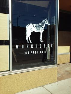 Window graphics for new coffee shop in St. Paul. Cut white vinyl with intricate detail in the horse logo - worth the effort for this great sign! 763-432-7630