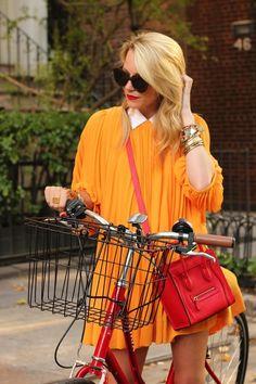 Fashion blogger Blaire Eadie and her red hot bicycle.Dress: H  M (old). Shirt:Equipment. Shoes: Bloch c/o. Purse: Celine. Sunglasses:Karen Walker 'Number One'. Lips: MAC 'Ruby Woo'. Nails: Essie 'Lollipop'. Jewels: Jcrew, Gap, BR, Juicy, David Yurman, BaubleBar.(via Atlantic-Pacific: cruisin')