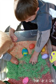 Easter Egg Sensory Bin with colored and scented rice from Train up a child
