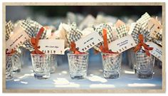 mini bags of candy in shot glasses that also work as escort cards! multi-function favors can save money while inspiring creativity