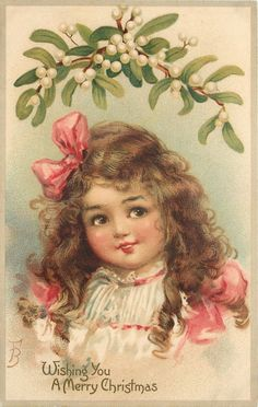 WISHING YOU A MERRY CHRISTMAS  head and shoulders of girl with pink ribbons in hair, under mistletoe