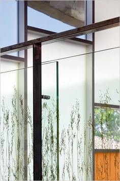 super creative - laminated rice grass on tempered glass railing - love the look.