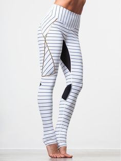 You'll be ready to battle any workout when you slide into these pinstriped, luxurious and sexy leggings from Lucas Hugh! The hot detailing on either side, coupled with the extra wide comfort waistband, back zip pocket for carrying your essentials and strategic mesh panels to keep you cool make these leggings a must-have for your workout wardrobe.