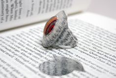 LITTLEFLY Literary Jewels. This jewellery is made by laminating hundreds sheets of book pages together. {by Jeremy May} #ring #recycled