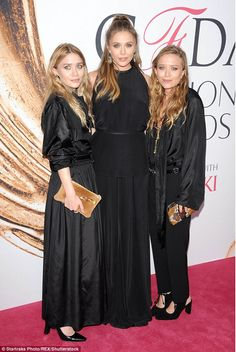 Three's a crowd: Elizabeth Olsen took center stage alongside her designer sisters, Mary-Kate and Ashley Olsen, in different variations of all black ensembles