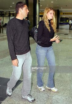 French-Greek Athina Onassis (R) arrives with her boyfriend Brazilian Alvaro Alfonso de Miranda Neto, known as Doda, at Porto Alegre's airport, southern Brazil 27 April 2005. The couple will take part in the equestrian XXXVII International Jump Championship, also known as The Best Jump. AFP PHOTO / JEFFERSON BERNARDES