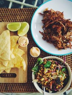 Pulled pork tacos with charred corn slaw and chipotle lime mayo.