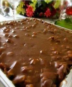 Ingredients:  -FOR THE CAKE: 2 cups Flour 2 cups Sugar 1/4 teaspoon Salt 4 Tablespoons (heaping) Cocoa 2 sticks Butter 1 cup Boiling Water 1/2 cup Buttermilk 2 whole Beaten Eggs 1 teaspoon Baking Soda 1 teaspoon Vanilla -FOR FROSTING: 1/2 cup Finely Chopped Pecans 1-3/4 stick Butter 4 Tablespoons