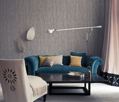 Blue couch and striped living room wall