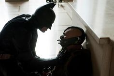 Batman (Christian Bale) and Bane (Tom Hardy) in TDKR