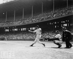 Ted Williams launching a home run against the Indians in old Cleveland Municipal Stadium - late 1950's.