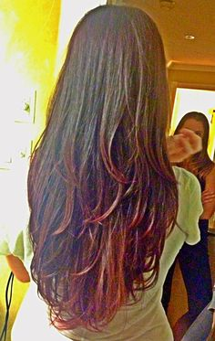 New hair cut and color. Long hair with layers, ion medium intense red color.