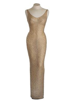 "NEW YORK (AP) — The flesh-colored, skin-tight beaded gown Marilyn Monroe wore during her breathless rendition of ""Happy Birthday"" to President John F. Kennedy is going on the auct Happy Birthday Mr President, Sheer Dress, White Dress, Beaded Gown, The Most Beautiful Girl, Designer Gowns, Skin Tight, Marilyn Monroe, Vintage Outfits"