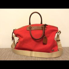 """Dooney and Bourke Juliette Satchel in red canvas Roomy and versatile satchel from Dooney and Bourke in red canvas with yellow interior. Leather handles. Adjustable shoulder straps. Small ink stain on inside (can view in picture). Other than that great condition. 14""""W x 13""""H x 5""""D with a 4"""" leather strap drop and adjustable shoulder strap of 5""""-16"""" Dooney & Bourke Bags Satchels"""