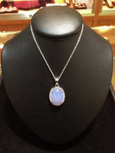 This beautiful Lavender Chalcedony Cabochon pendant is surrounded by diamonds, and available for YOU now at Becker's!