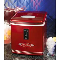 The Retro Series 26 lb. Portable Ice Maker is a stylish, portable ice maker designed for countertop use to complement any kitchen, home bar or office. This ice machine can produce up to 26 lbs. of ice per day and hold up to one gallon of water. Just plug it in, fill the reservoir with water, choose your ice size and watch it go to work. With a unique, vintage design in bright red, it offers a stylish look that's perfect for parties.