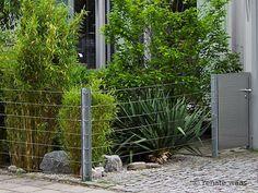eine schöne und kostengünstige Idee für einen Zaun aus Stahl und Stahlseilen