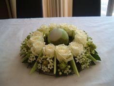 Round table decoration - 12 white Avalanche roses, 12  ornithogalum Arabicum, oasis wreath and pieces of light green oasis rainbowfoam