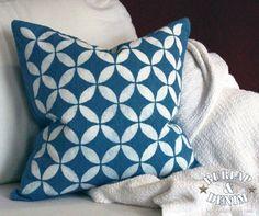 Spray bleach over a stencil to make a design like this denim pillow tutorial