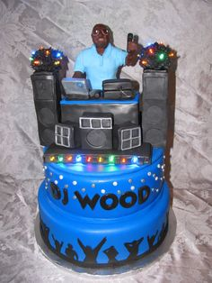 A Disc Jockey Cake with Lights too!!!! DJ hand scultpted out of chocolate!!!