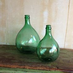 Vintage wine bottles add a little bit of sparkle to any space.  Find them at www.mercatoantiques.com