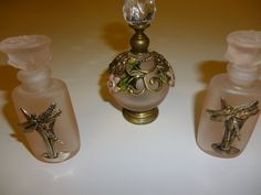two dragonfly decorated pink glass Silver Scene scents and one Shudehill filigree decorated pink glass scent bottle