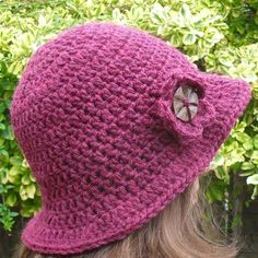 The hat is crocheted with wool and acrylic yarn, in a rich cranberry colour. The hat has a detachable flower brooch in the same . Cloche Hat, Brim Hat, Crochet Hat With Brim, Magenta, Purple, Cranberry Color, Flower Brooch, Fabric Crafts, Wool