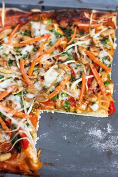 Thai Red Curry Pizza.... I made the sauce & left out the chicken. Used another pizza dough recipe. Topped with chopped fresh basil. Enjoyed by all. Will make again.
