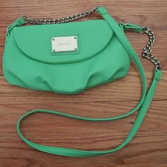 Nine West Mint Green Crossbody Handbag Like New!  Small crossbody handbag from Nine West.  Faux leather is a gorgeous and bright mint green, perfect for summer!  Long strap with silver chain accent and silver plaque with the Nine West logo.  Snap closure with inner zippered pocket.  This handbag is the perfect size for carrying all your essentials when you want a smaller bag.  Note:  There is a small dark spot on the strap as shown in the 2nd pic. Nine West Bags Crossbody Bags