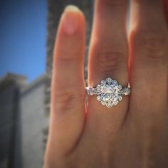 a floral inspired halo engagement ring available at Diamonds by Raymond Lee in 14k white gold.