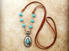 Long Turquoise necklace - long leather Necklace - concho pendant silver necklace - Long boho Necklace - western jewelry - boho jewelry by Lendilia on Etsy https://www.etsy.com/listing/489472550/long-turquoise-necklace-long-leather