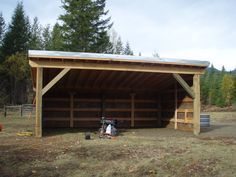 """We have almost finished fencing the new pasture so now we have been working on a """"loafing shed"""" for the cattle this winter. I have no idea why it is called a loafing shed – maybe …"""