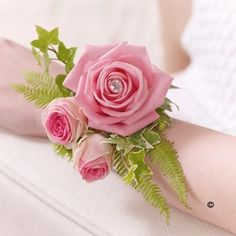 The vintage style of this classic pink rose has an effortless beauty that never dates. For this pretty wrist corsage we've added light green, delicate foliage and a sparkling diamante pin. If you would like to order this corsage or any of our floral arrangements for your #wedding or #prom , give us a call on 0161 861 0524 and we'll be happy to help.