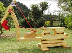 A sandbox toy is a wooden excavator.