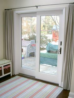 Sliding doors need curtains too! Rod placement should be higher tho!