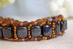 Hematite Flat Spiral with Fire-polish and by DezodDaughtersStudio