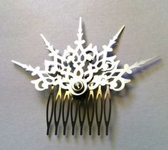 This is a single Argent Fractals hair comb. It can be worn a multitude of ways! The longest hand is just about 2.5 long from the fastener hole. Its