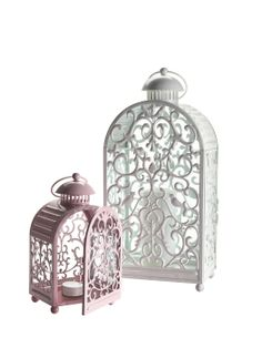 The warm light of a candle shines decoratively through the pattern on IKEA GOTTGÖRA lanterns for a bit of old-world style romance.