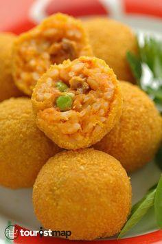 STREET FOOD. In Sicilia non è un trend ma un rito, ecco la ricetta classica degli arancini