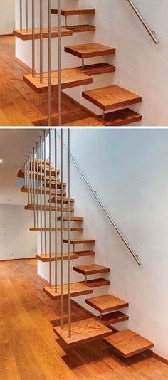 escalier intérieur suspendu à marches décalées flottantes dans les aires