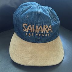 NWOT Las Vegas Sahara baseball hat, Rare! This is an excellent baseball hat, fully adjustable, and brand-new. It is a collectors item because the hotel no longer exists. This hat is blue denim and tan suede. Accessories Hats