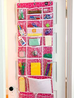 """A behind the door """"Variety Stash Organizer"""" that has pockets to fit pieces of paper.  Great for the front closet for homework!"""