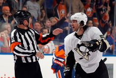 Kris Letang #58 of the Pittsburgh Penguins argues a penalty call with referee Dan OHalloran #13 during the game against the New York Islanders in Game Four of the Eastern Conference Quarterfinals.