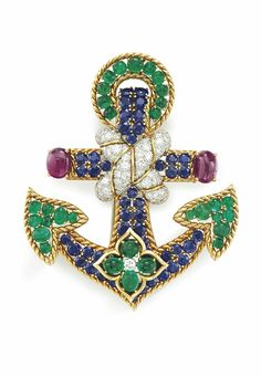 A MULTI-GEM AND DIAMOND ANCHOR PENDANT BROOCH, BY DAVID WEBB: Designed as a wirework gold anchor set with circular-cut sapphires, cabochon emeralds and rubies, enhanced at the center with entwined circular-cut diamond ropes, 3 1/4 ins., mounted in platinum and 18k gold. Signed Webb for David Webb. Via Christie's.