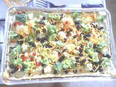 FRESH VEGETABLE PIZZA!!! 2 pkgs. crescent rolls 2 8 oz. pkgs. cream cheese, softened 1 cup mayonnaise 1 pkg. dry Hidden Valley Ranch Dressing 1/2 CUP CHOPPED:  onion cauliflower broccoli radishes (optional) green peppers olives carrots cheddar cheese Press rolls into pan, without gaps Bake 350 for 10 min COOL Mix cream cheese, mayo, ranch dressing & spread over rolls. Top with desired vegetables. Cut into squares Refrigerate until ready to serve