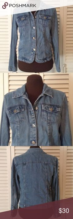 Denim Jacket Waist style Denim but not a heavy denim.  Front has rounded edges at buttons.  Has side pockets and top pockets.  Jacket has a very nice fade. Coldwater Creek Jackets & Coats Jean Jackets