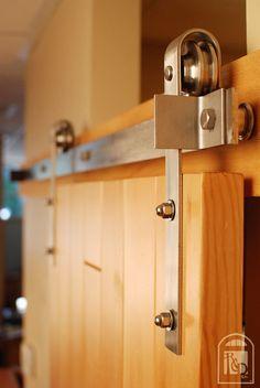 - sliding barn door - stop on pre made hardware