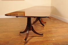 http://www.canonburyantiques.com/s/tables/regency-dining-tables/1/  Regency pedestal dining table - works on an extending leaf system. From Canonbury Antiques...