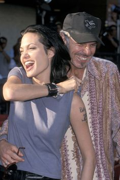 Giggling with then husband Billy Bob Thornton at the Gone in 60 Seconds premiere in June 2000.
